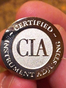 The certification lapel pin.