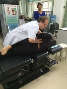 Back pain patient receiving a classic low back side posture adjustment.